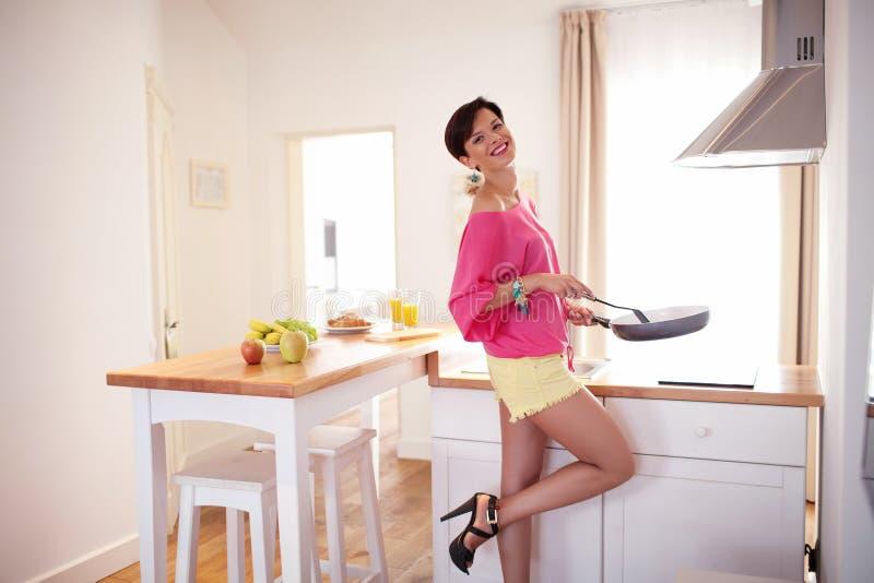 Beautiful girl prepare breakfast royalty free stock photos