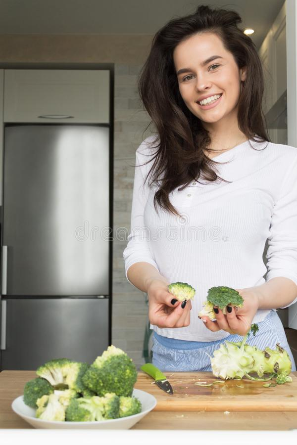 Beautiful Girl Preparing Broccoli. Losing weight. Nutrition royalty free stock photography