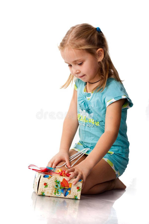 Beautiful girl with a present. Isolated on white stock photo