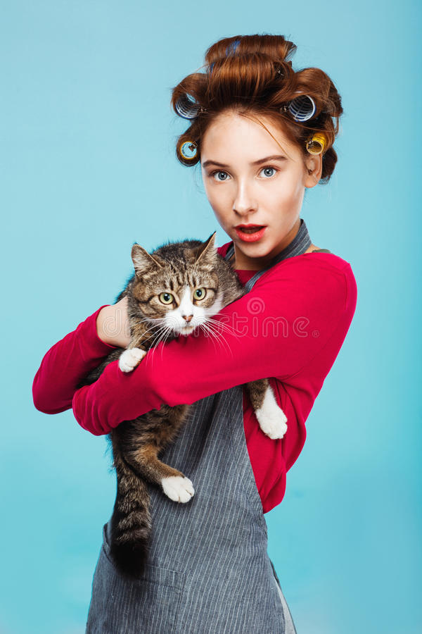 Beautiful girl with pretty cat in hands posing and looking to camera stock image