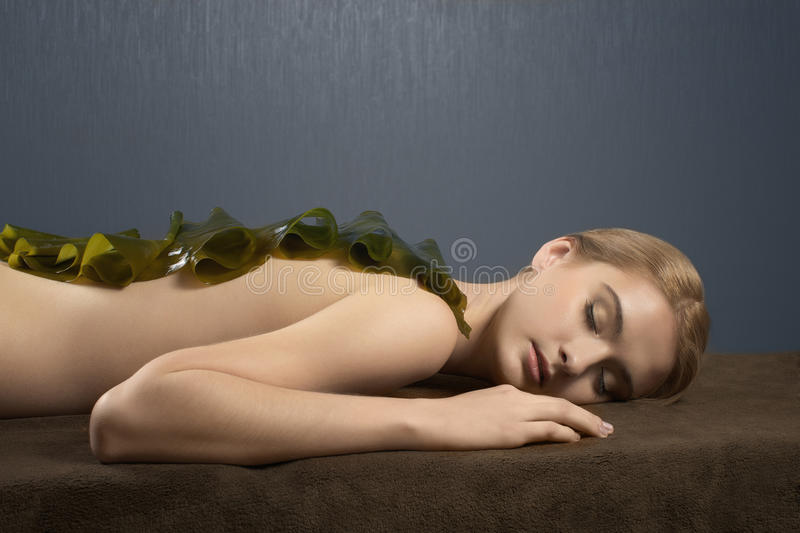 The beautiful girl on procedure of massage royalty free stock photography