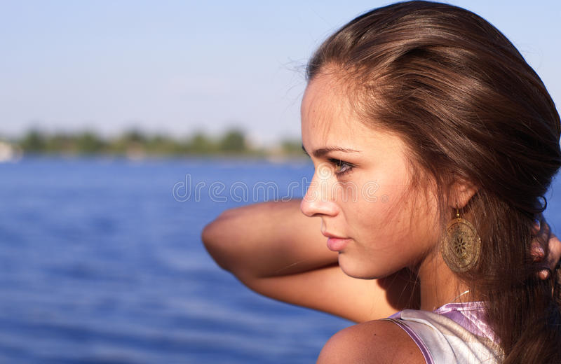 Beautiful girl profile at the river royalty free stock image