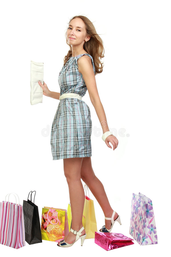 Beautiful girl with purchases. royalty free stock photos