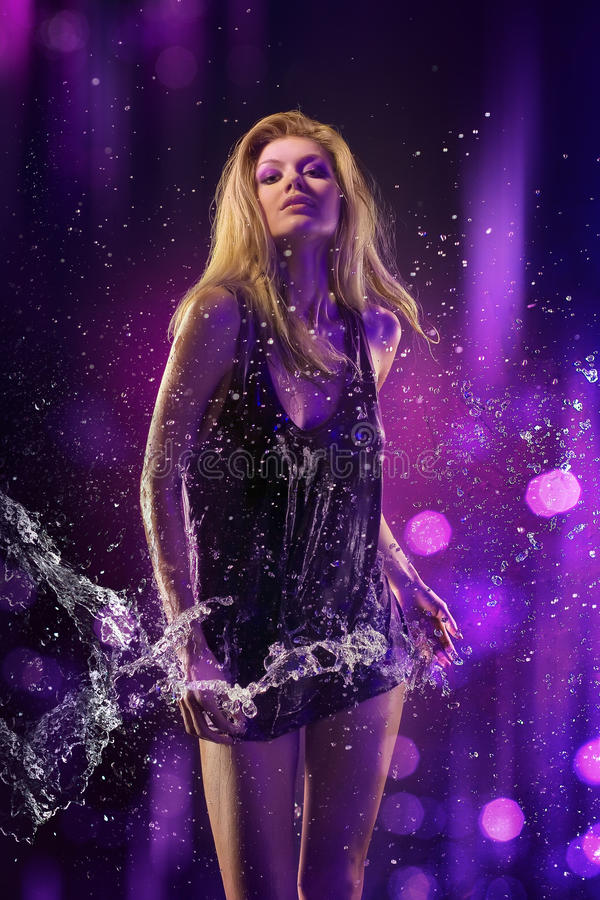 Beautiful Girl Purple Background And Water Royalty Free Stock Photography