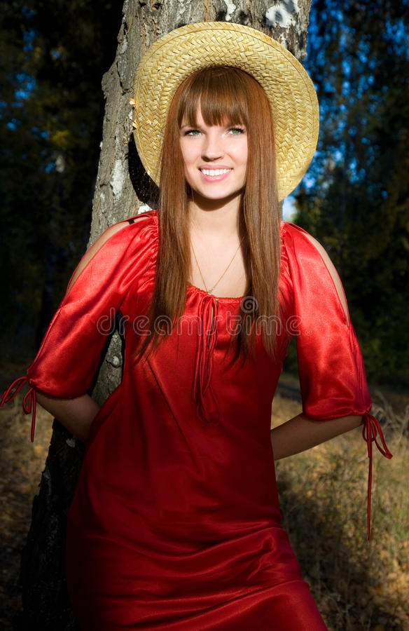 Download Beautiful Girl In A Red Dress And A Straw Hat Stock Image - Image: 11363701
