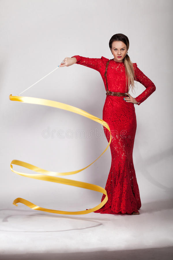 Beautiful girl in a red evening dress stock photos