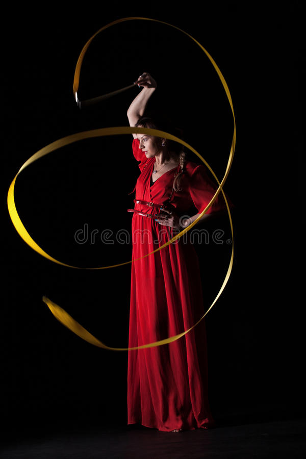 Beautiful girl in a red evening dress stock image
