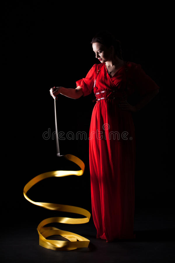 Beautiful girl in a red evening dress royalty free stock photo