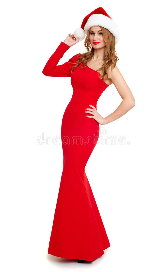 Beautiful girl in red gown and santa hat isolated on white background, winter holiday concept stock photo