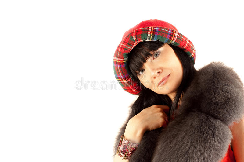 Beautiful girl in a red hat royalty free stock images