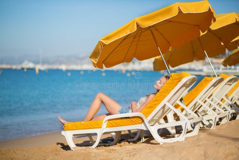 Beautiful Girl Relaxing On A Beach Chair Stock Photo