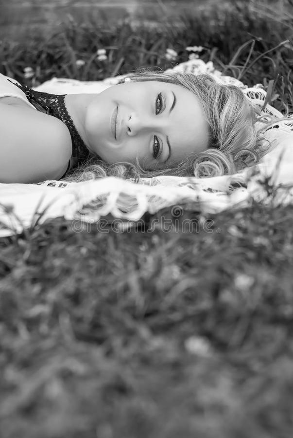 Beautiful girl relaxing on the grass stock photography