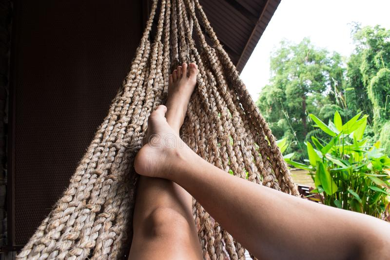 Beautiful girl relaxing in a hammock at home royalty free stock image