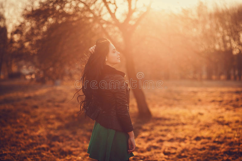 Beautiful girl relaxing in the park royalty free stock image