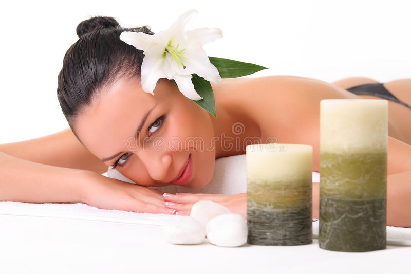 Beautiful girl relaxing in spa. Isolated on white royalty free stock images