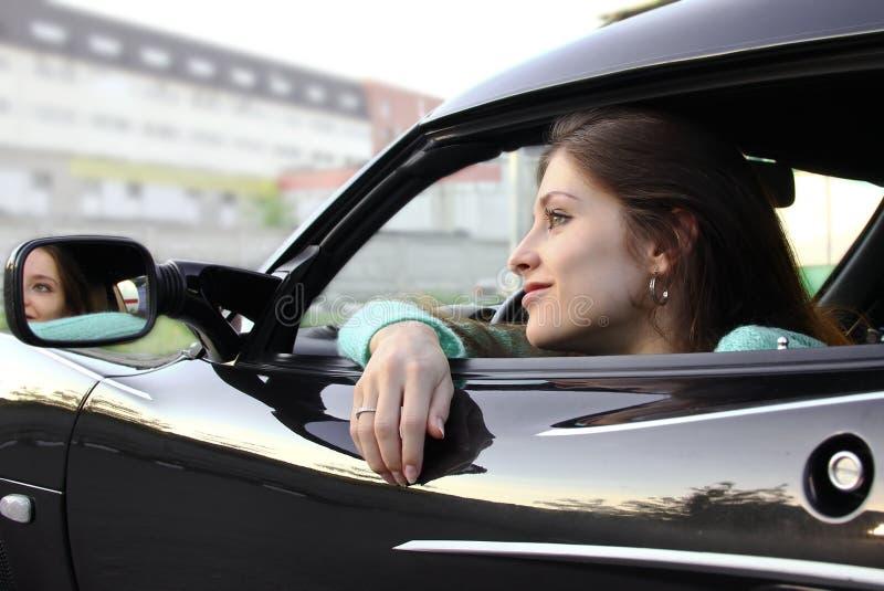 Beautiful girl relaxing in sport auto stock photo