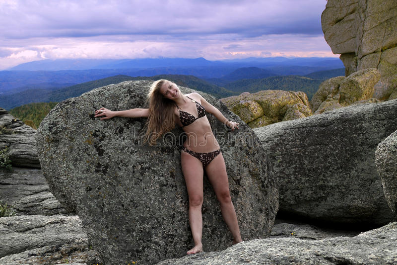 Beautiful girl on rest in mountains stock images