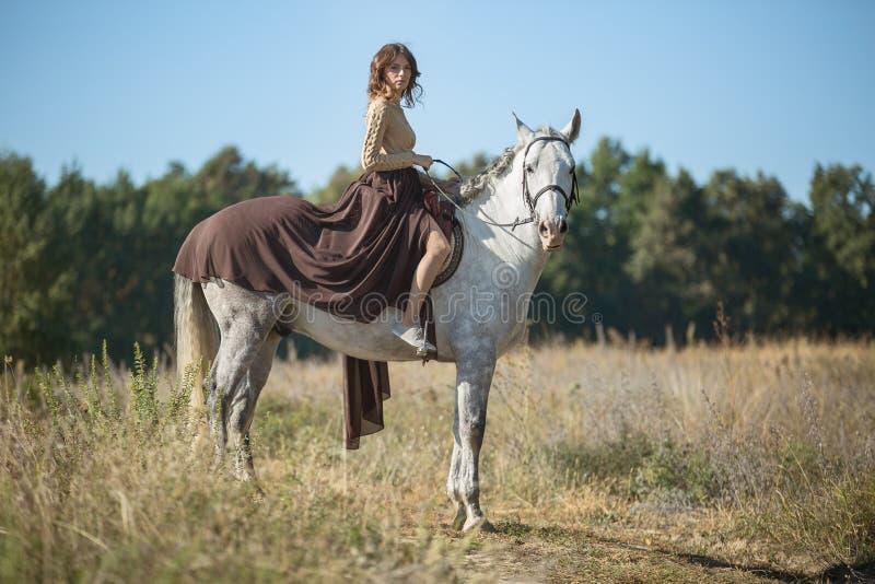 Beautiful girl riding stock image
