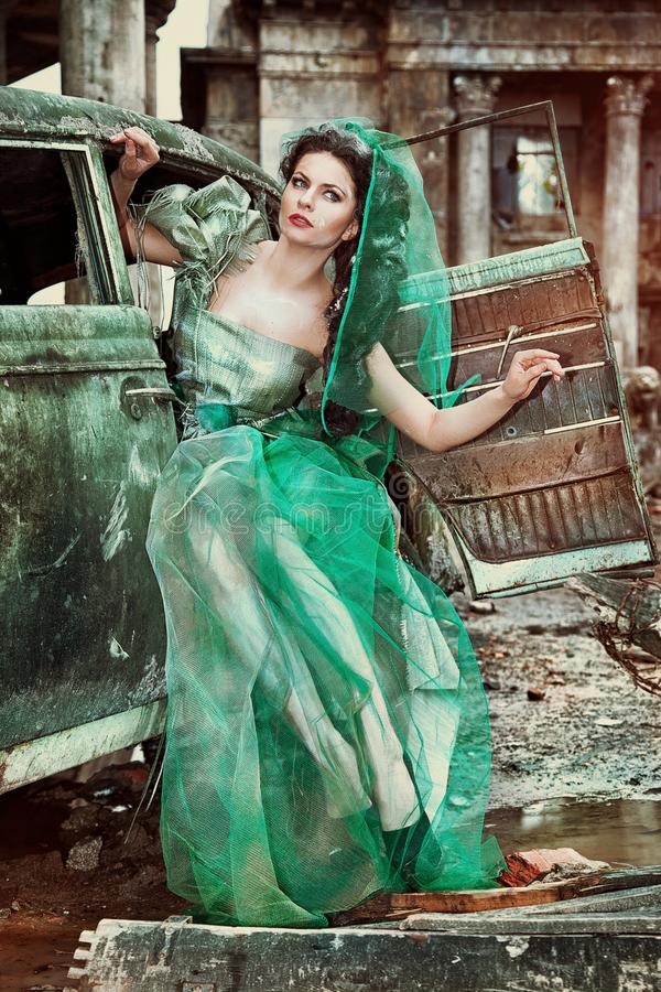 Beautiful girl in the ruins of the city. royalty free stock photography