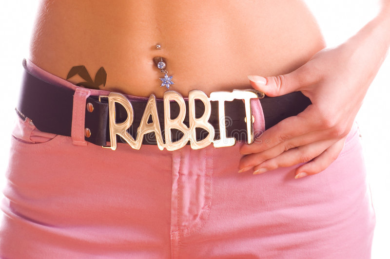 Beautiful girl's body with tattoo and luxury belt with silver bu stock images