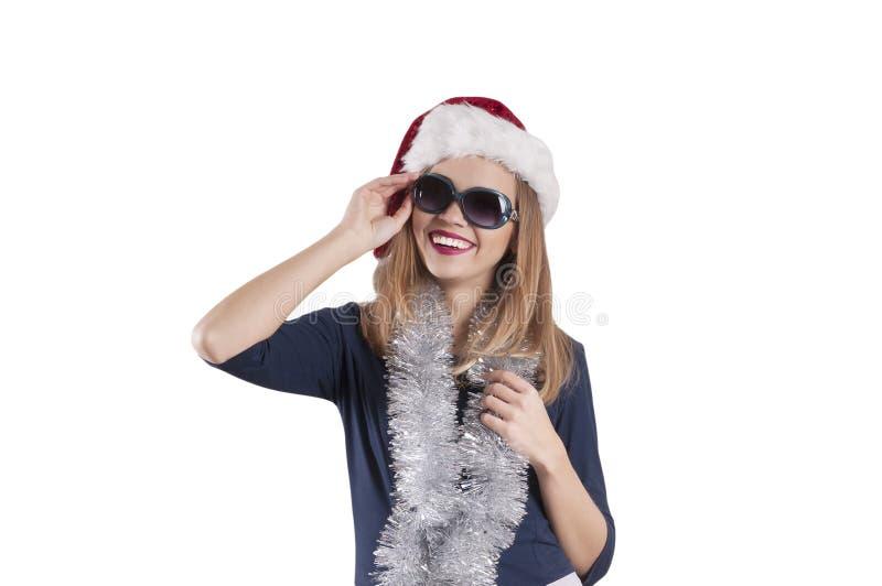 Beautiful girl in santa hat black glasses dress isolated emotion fashion stock images