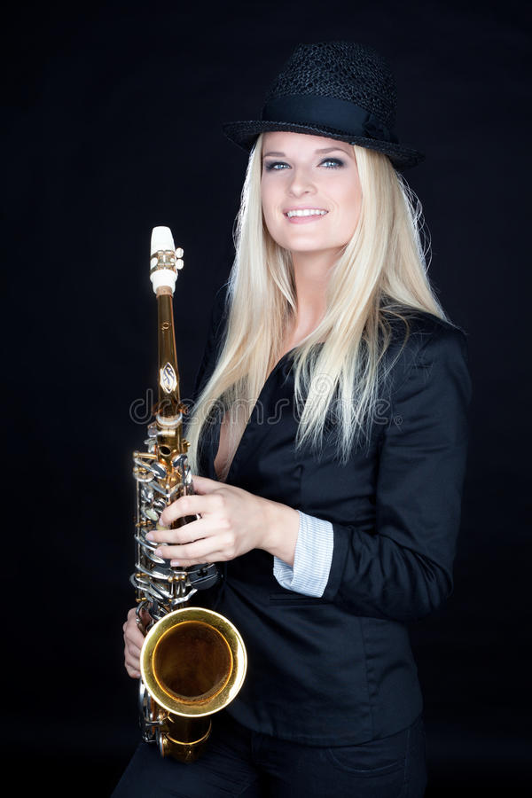 Beautiful girl with saxophone royalty free stock image