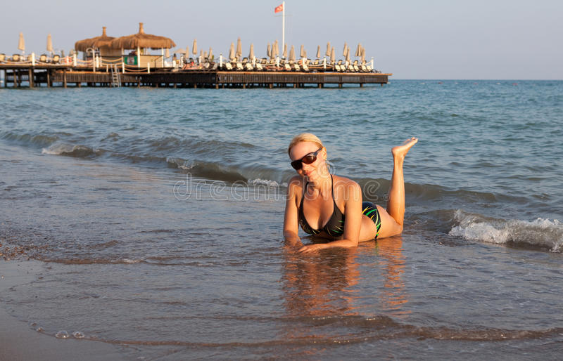 Beautiful girl on sea beach. royalty free stock images