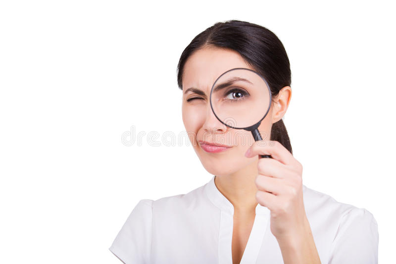 Beautiful girl searching with magnifier. Isolated. Beautiful girl portrait looking through magnifier. Isolated royalty free stock photography