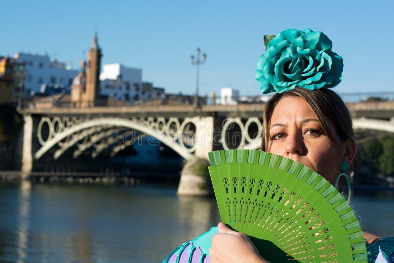 Beautiful girl in Seville. Beautiful woman flamenco in april fair royalty free stock photo