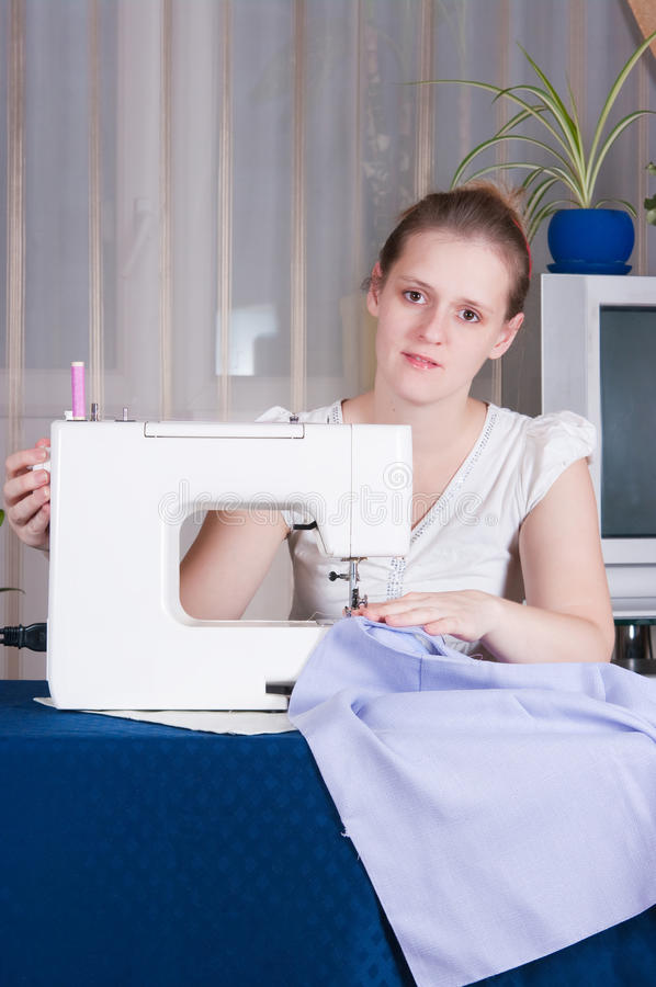 Free Beautiful Girl Sewing Royalty Free Stock Images - 12185789