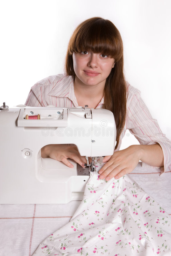 Beautiful girl sewing (v.2) stock image