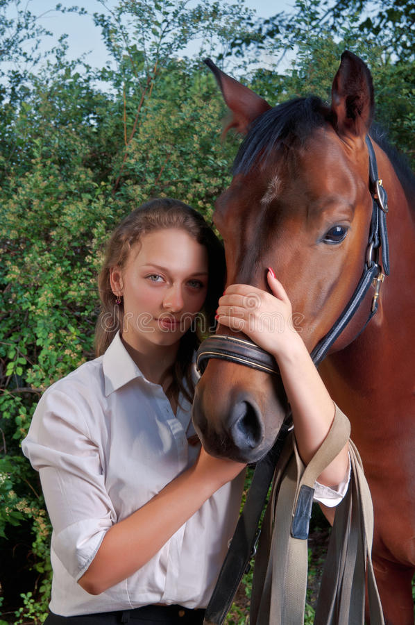 Download Girl In A Shirt And A Horse Stock Photo - Image: 29877792