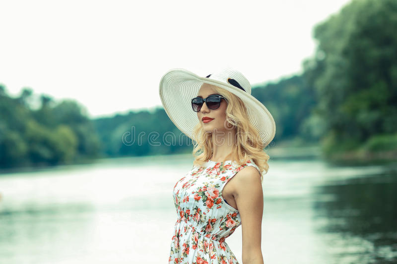 Beautiful girl on the shore stock image