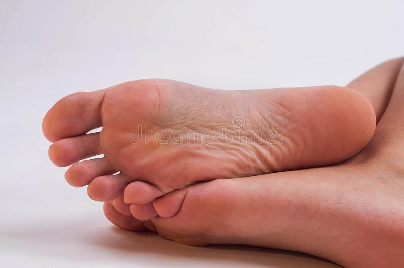 Cute girl soles and feet stock images