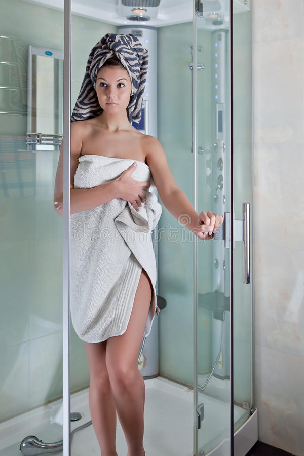 Beautiful girl after a shower in a white towel stock image