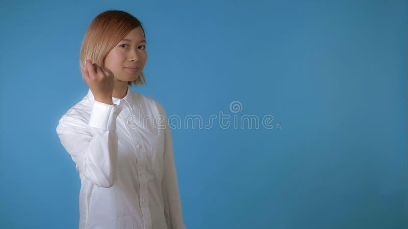Beautiful girl shows hand gesture knock knock stock image