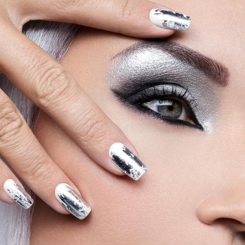 Beautiful girl with the silver makeup and nails. royalty free stock images
