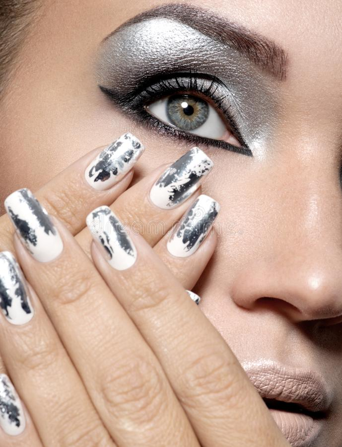 Beautiful girl with the silver makeup and nails. royalty free stock photography