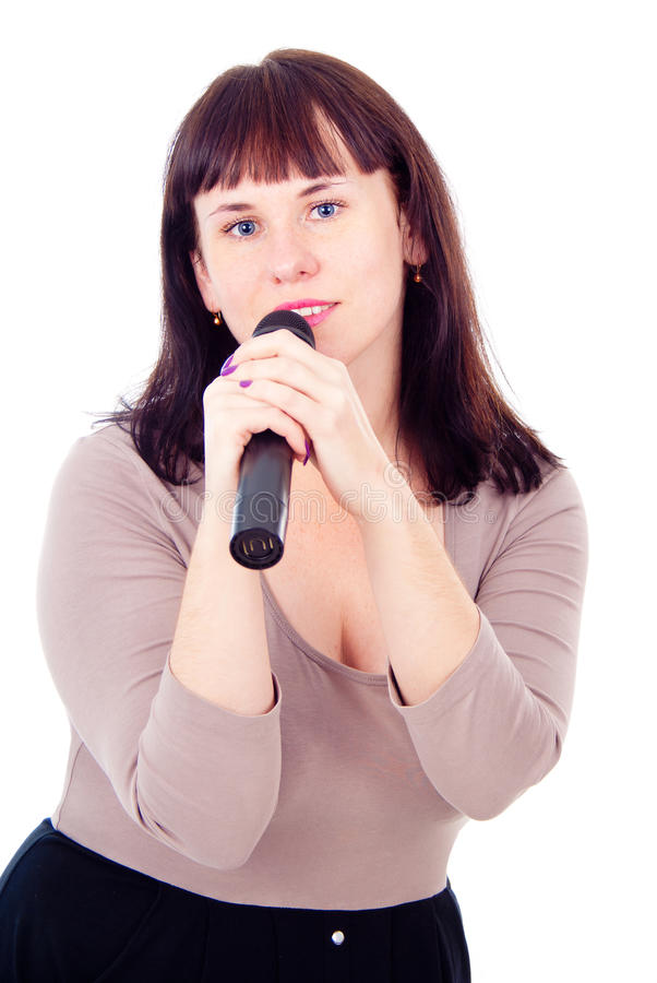 Download Beautiful Girl Singing Into The Microphone Royalty Free Stock Images - Image: 27546969