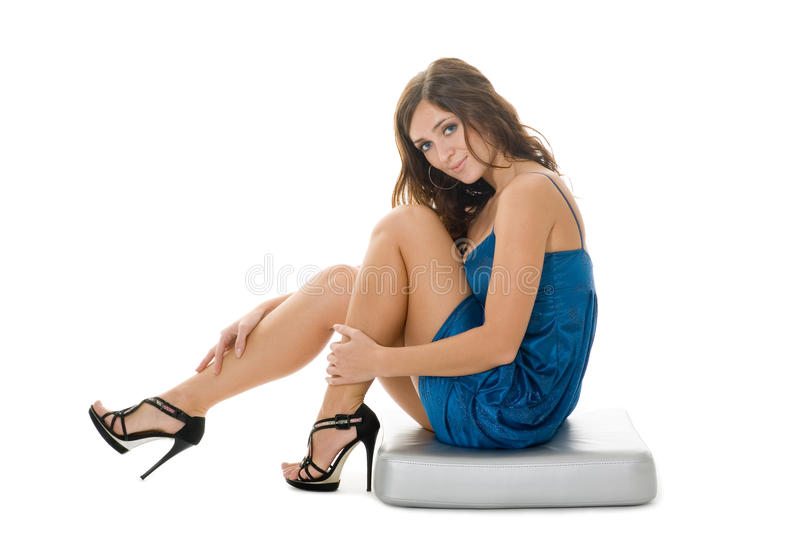 Beautiful girl sits on a decorative pillow royalty free stock images