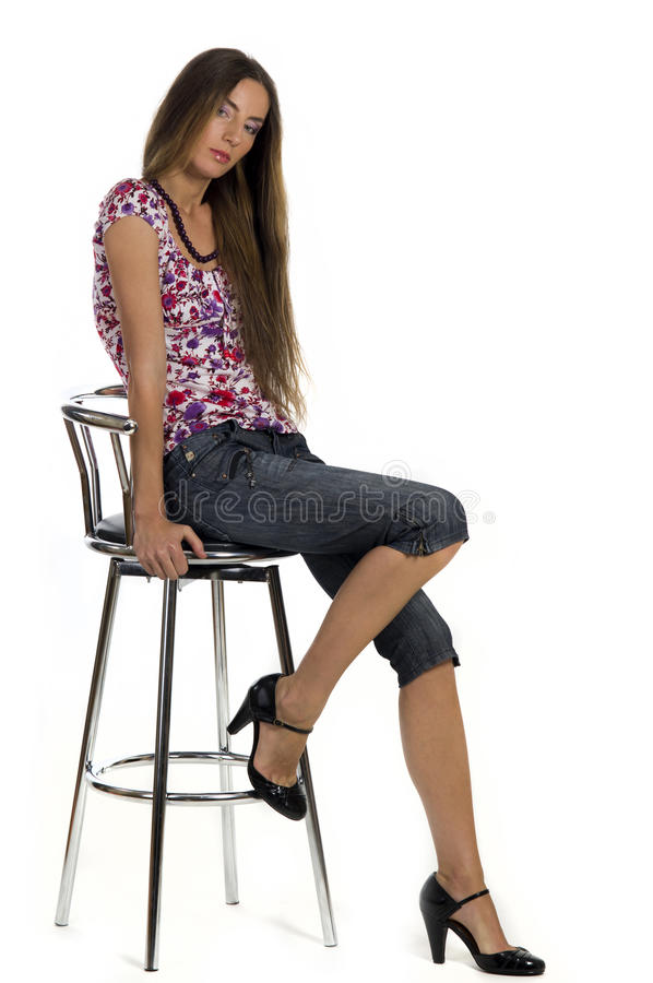 Free Beautiful Girl Sits On The Bar Stool Royalty Free Stock Photography - 21195157