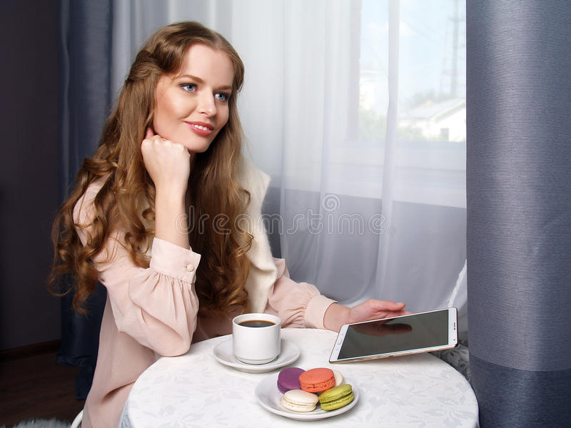 Beautiful girl sitting in the cafe stock photos