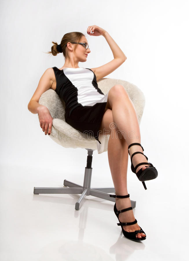 A Beautiful Girl Sitting On A Chair Stock Photo Image