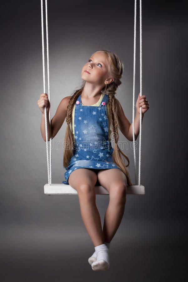 Download Beautiful Girl Sitting On Swing Stock Image - Image of dreamy, blonde: 26318849