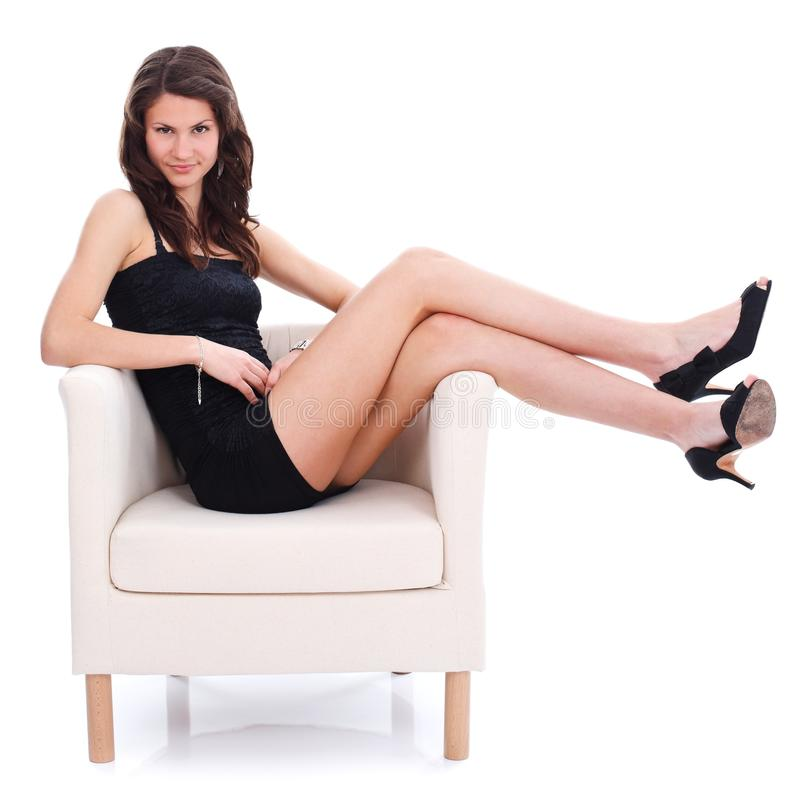 Beautiful Girl Sitting On White Armchair Royalty Free Stock Photography