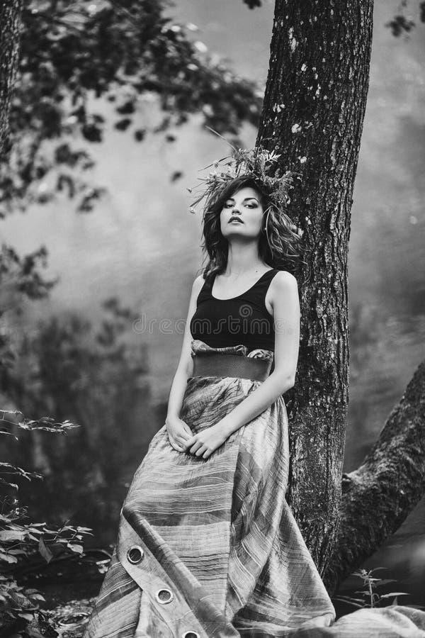 Beautiful girl with a Slav wreath on head stock photo