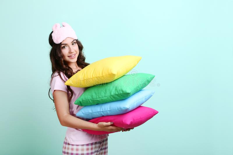 Girl with mask and colorful pillows royalty free stock photos