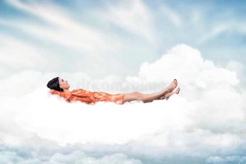 Girl on a cloud stock photos