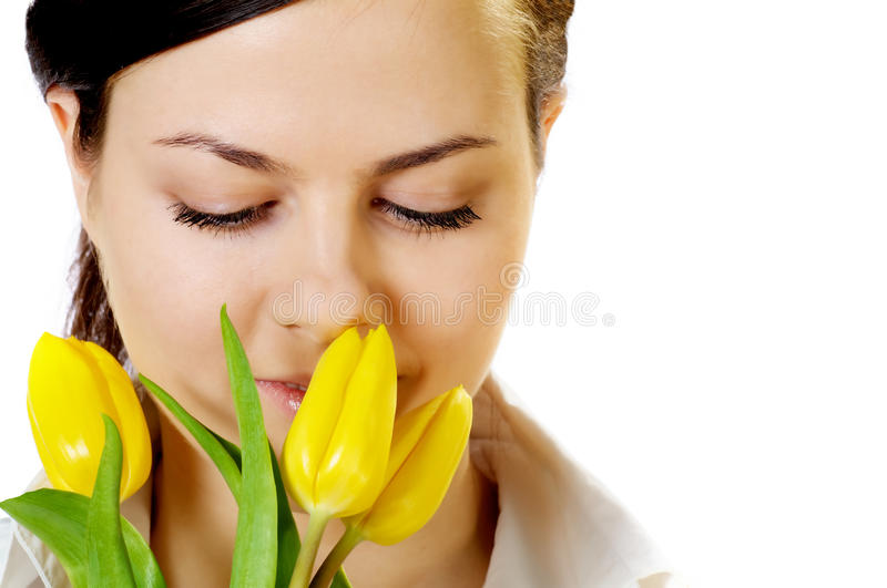Download Beautiful Girl Smells Yellow Tulips Stock Photography - Image: 23842792