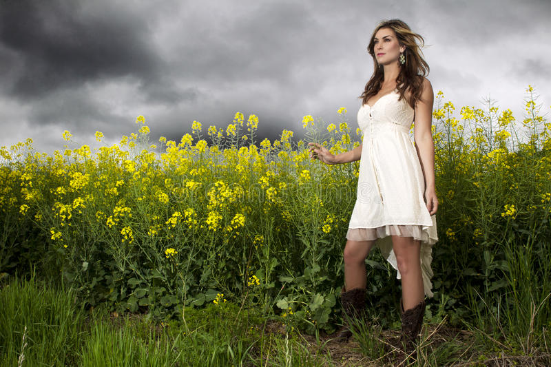 Download A Beautiful Girl Smiling In A Field Of Yellow Flowers Stock Image - Image: 30786495